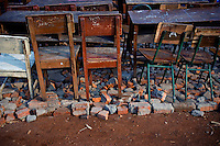 Chairs and desks sit on bricks before they are moved from their current location to the new site of the Kartini Emergency School. In September 2007 city authorities evicted the school from its location under a North Jakarta highway. Undaunted, students and the 'Twin Teachers' moved the school piece by piece to its new temporary home. Since the early 1990s, twin sisters Sri Rosyati (known as Rossy) and Sri Irianingsih (known as Rian) have used their family inheritance to set up and run 64 schools in different parts of Indonesia, providing primary education combined with practical skills to some of the country's most deprived children.