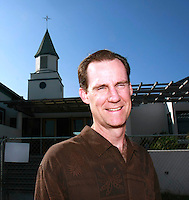 Friday, June 27, 2008:  Pastor Brian Daly stands in front of the construction fencing surrounding the Pacific Beach Christian Church on the corner of Loring and Dawes in Pacific Beach, CA, USA.  After a false start, construction of a major expansion of the church is underway.
