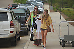 University of Mississippi freshman student Abby Posey (left) and senior Katie Smith move a rack of clothes into a dorm in Oxford, Miss. on Wednesday, August 17, 2011. Classes for the fall semester begin Monday, August 22, 2011.