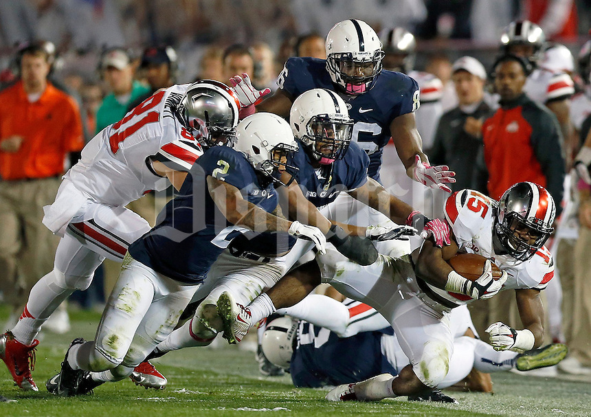 Ohio State Buckeyes running back Ezekiel Elliott (15) gets knocked out of bounds during the 4th quarter of the NCAA Division I football game at Beaver Stadium in University Park, PA on October 25, 2014. (Columbus Dispatch photo by Jonathan Quilter)
