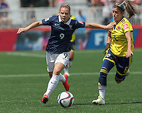Moncton, New Brunswick - June 13, 2015:  In a FIFA Women's World Cup Canada 2015 Group F match, Colombia (yellow/blue) defeated France (blue/white), 2-0, at Moncton Stadium.