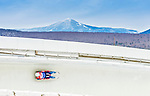 5 December 2014: Victor Kneyb, sliding for Russia, slides through Curve Number 14 on his first run, ending the day with a 9th place finish and a combined 2-run time of 1:43.656 in the Men's Competition at the Viessmann Luge World Cup, at the Olympic Sports Track in Lake Placid, New York, USA. Mandatory Credit: Ed Wolfstein Photo *** RAW (NEF) Image File Available ***