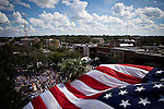 A giant American flag waves over a campaign rally for Republican vice presidential candidate Rep. Paul Ryan in Ocala, Florida, October 18, 2012.