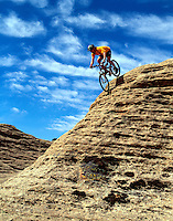 Jeff Haskin, an adrenaline junkie, enjoys slickrock.near Rockville, Utah. (MR)
