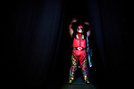 Lucha Libre AAA wrestler Abismo Negro pumps himself backstage before a match in San Jose, CA March 29, 2009.