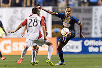 Fabio Alves (Fabinho) (33) of the Philadelphia Union plays the ball under pressure from Mark Bloom (28) of Toronto FC. The Philadelphia Union defeated Toronto FC 1-0 during a Major League Soccer (MLS) match at PPL Park in Chester, PA, on October 5, 2013.