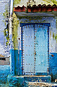 A door of myriad blue hues in the town of Chaouen, Morocco.