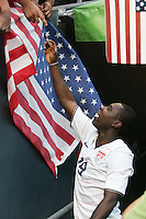 Freddy Adu signs an American flag. USA defeated Grenada 4-0 during the First Round of the 2009 CONCACAF Gold Cup at Qwest Field in Seattle, Washington on July 4, 2009.