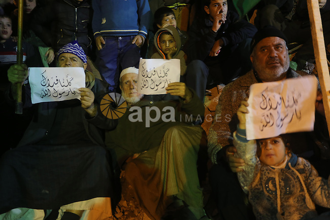 Palestinians take part in a protest against a cartoon of the Prophet Mohammed that was published by the French satirical magazine Charlie Hebdo in an edition issued a week after 12 people were killed by Islamist gunmen at its Paris offices, in Jabaliya in the northern Gaza Strip, on January 20, 2015. The image has angered many Muslims as depictions of Prophet Mohammed are widely considered forbidden in Islam, and has triggered protests in Asia, Africa and the Middle East, some of which turned deadly. Photo by Mohammed Asad