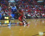 Ole Miss guard Chris Warren (12)  drives against Kentucky's Darius Miller (1) at the C.M. &quot;Tad&quot; Smith Coliseum in Oxford, Miss. on Tuesday, February 1, 2011. Ole Miss won 71-69.