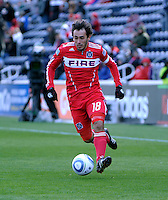 Chicago Fire forward Gaston Puerari (18) dribbles toward the Sporting KC goal.  The Chicago Fire defeated Sporting KC 3-2 at Toyota Park in Bridgeview, IL on March 27, 2011.