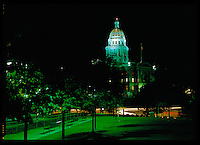 State Capital building bathed in green light at night. Located in Denver, Colorado.