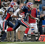 26 November 2006: Buffalo Bills wide receiver Roscoe Parrish (11) returns a punt for an 82 yard touchdown run against the Jacksonville Jaguars at Ralph Wilson Stadium in Orchard Park, NY. The Bills defeated the Jaguars 27-24. Mandatory Photo Credit: Ed Wolfstein Photo<br />