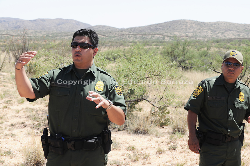 Sasabe, Arizona – Tucson Sector Border Patrol speaker Mario Escalante addresses reporters prior to a demonstration of a rescue by the Border Patrol Search, Trauma, and Rescue Unit (BORSTAR), during an event that took a group of journalists on a walk through the Arizona desert. BORSTAR is a specialized unit that responds to emergency search and rescue situations. U.S. Customs Border Protection (CBP) transported journalists to this remote area where they walked through a 1.3 miles trail during a two-day event organized by the Tucson Sector Border Patrol. The event brought national and international journalists to the Arizona desert to become acquainted with the dynamics of this area. This area is located near the Sasabe Port of Entry, a border-crossing station located in southern Arizona, and about 70 miles from the City of Tucson. Sasabe is one of the most isolated ports along the 2,000-mile U.S.-Mexico border, and it connects the towns of Sasabe, Arizona and El Sasabe, Sonora (Mexico). The border-crossing station is located in one of the busiest human and drug smuggling corridors of the U.S.-Mexico border. Photo by Eduardo Barraza © 2012