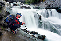 Pragraten am Grossvenediger, East Tyrol, Austria, September 2009. I hiker enjoys the Umbalfall waterfalls. The new 360 degree Ost Tirol hiking trail runs partly through the High Tauern National Park and is a unique high alpine trail of 360 kilometer. Photo by Frits Meyst/Adventure4ever.com