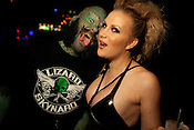 "Eric ""The Lizardman"" Sprague and Courtney Crave at the 2010 Freaks & Fetish Party in Dallas, Texas.  The Lizardman was the MC for the night and Courtney Crave was the event's coordinator. The Freaks & Fetish Party kicked off the second annual Dallas Suscon, or suspension convention, in Dallas, Texas. Body suspension has gained mainstream exposure in recent years and suspension experts at Dallas Suscon are promoting safety and awareness."