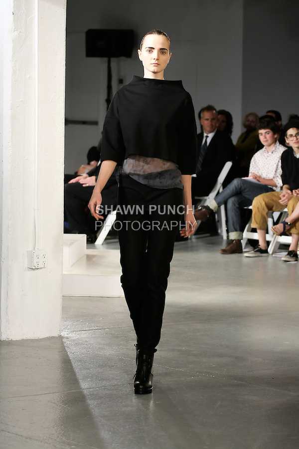 Model walks runway in an outfit by Emilie Cardin, for the 2012 Pratt Institute fashion show, at Center548 NYC, on April 26, 2012.
