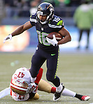 Seattle Seahawks wide receiver Tyler Lockett (16) tries to break the ankle tackle by San Francisco 49ers cornerback Marcus Cromartie (47) at CenturyLink Field in Seattle, Washington on November 22, 2015.  The Seahawks beat the 49ers 29-13.   ©2015. Jim Bryant Photo. All RIghts Reserved.