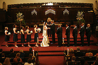 A bride and groom exchange rings in Westminster Presbyterian Church in Sacramento, California.