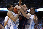 02 February 2015: North Carolina's Marcus Paige (5) takes the ball away from Virginia's Mike Tobey (10) with help from North Carolina's Kennedy Meeks (right). The University of North Carolina Tar Heels played the University of Virginia Cavaliers in an NCAA Division I Men's basketball game at the Dean E. Smith Center in Chapel Hill, North Carolina. Virginia won the game 75-64.