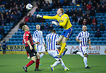 Kilmarnock v St Johnstone...06.12.14   SPFL<br /> Craig Samson punches clear from Steven Anderson<br /> Picture by Graeme Hart.<br /> Copyright Perthshire Picture Agency<br /> Tel: 01738 623350  Mobile: 07990 594431