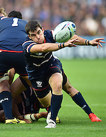 Niku Kruger of the USA passes the ball. Rugby World Cup Pool B match between South Africa and the USA on October 7, 2015 at The Stadium, Queen Elizabeth Olympic Park in London, England. Photo by: Patrick Khachfe / Onside Images