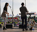 Lucy Schwartz and her guitarist Meghan Toohey perform Saturday at the Balboa Beach Music Fest.