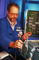 A technician tests computer circuits