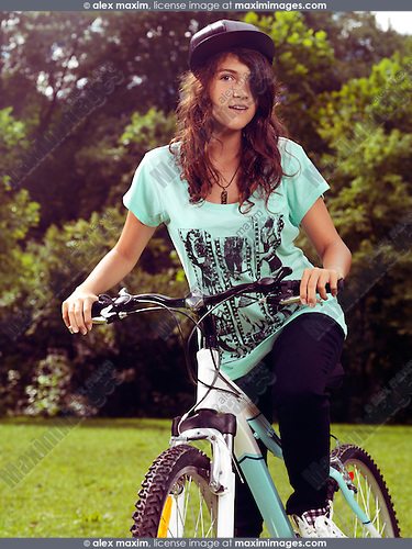 Portrait of a teenage girl on a bicycle summer nature scenic