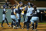 CHAPEL HILL, NC - FEBRUARY 24: UNC players celebrate at home plate at the end of the game<br />  The University of North Carolina Tar Heels played the Towson University Tigers on February, 24, 2017, at Anderson Softball Stadium in Chapel Hill, NC in a Division I College Softball match. UNC won the game 6-5 in nine innings.