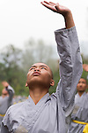 Student of Shaolin martial arts school practicing Qi Gong outside in DengFeng, Henan, China 2014