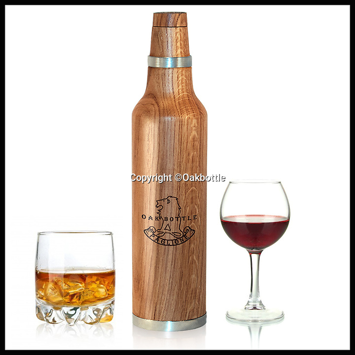 BNPS.co.uk (01202 55883)<br /> Pic: Oakbottle/BNPS<br /> <br /> *Please use full byline*<br /> <br /> The Oakbottle, and drink.<br /> <br /> This simple wooden bottle could be about to change the face of the lucrative drinks industry - because it promises to turn cheap booze into more expensive vintage-tasting drinks.<br /> <br /> The oak bottle replicates the ageing process of wines and spirits during which they sit in oak barrels and develop their flavour - but instead of taking months or years its makers say it takes as little as 24 hours to achieve the same effect.<br /> <br /> It means drinks lovers could potentially enjoy the oaky flavours of premium tipples without having to fork out the high prices they demand.  <br /> <br /> The original Oak Bottle, made from sustainably sourced American oak, costs $79.99 - around &pound;50 - from oakbottle.com.