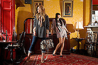 NO REPRO FEE.30/8/2010. AWEAR AUTUMN COLLECTION.EXCLUSIVE PICTURES FOR IRISH TIMES.(To accompany Deirdre McQuillans article) Yomiko Chen & Sarah Morrissey model a selection of dresses from A|wear's new autumn '10 collection at Kehoes Pub in Dublin. Sarah wears Swing grey coat - EUR80, Printed Blouse - EUR30 Skinny denims - EUR30 and Satchel bag - EUR35 .Yomiko Chen wears Printed dress - EUR45 and a Black studded bag - EUR25 The collection arrives instore and on www.awear.comfrom this week. Picture James Horan/Collins Photos