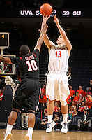 Dec. 22, 2010; Charlottesville, VA, USA; Virginia Cavaliers guard Sammy Zeglinski (13) shoots over Seattle Redhawks guard Sterling Carter (10) during the game at the John Paul Jones Arena. Seattle Redhawks won 59-53. Mandatory Credit: Andrew Shurtlef