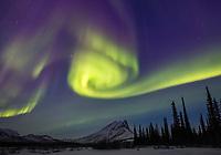 Aurora dances over Sukakpak mountain in the Brooks Range in Alaska's arctic.