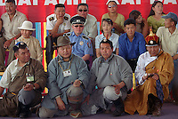 Ulaanbaatar, Mongolia, July 2003..Competitors in the ankle bone shooting contests in the national Naadam at Ulaanbaatar central stadium.