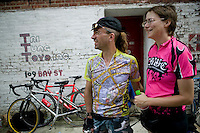 3 July 2005 - Jersey City, NJ, USA - Newlyweds from London, England, Gertie (L) and Rosie Smyrle watch the final race of the 13th annual cycle messenger world championships, Jersey City, USA, July 2nd 2005. More than 700 riders from all over the world took part in the 4-day competition which carries event based on the daily work of a city bike messenger.