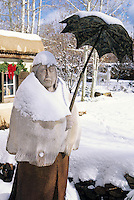A Sculpture by Doug Hyde in the canyon road garden of Santa Fe gallery owner Nedra Matteucci  becomes especially endearing when covered with winter snow.