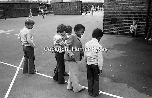 Junior school children playing playground games. South London. 1970s England. UK..