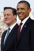U.S. President Barack Obama (R) welcomes British Prime Minister David Cameron during an official arrival ceremony at the South Lawn of the White House March 14, 2012 in Washington, DC. Prime Minister Cameron was on a three-day visit in the U.S. and he was expected to have talks with President Obama on the situations in Afghanistan, Syria and Iran. .Credit: Chip Somodevilla / Pool via CNP