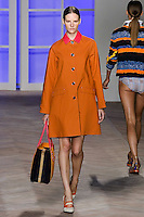 Sara Blomqvist walks the runway in an orange/pink cotton raincoat, by Tommy Hilfiger for the Tommy Hilfiger Spring 2012 Pop Prep Collection, during Mercedes-Benz Fashion Week Spring 2012.
