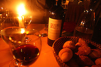 Red wine and fresh bread are served waiting for the food in a Palermo restaurant.