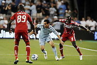 Omar Bravo (blue) Sporting KC, Yamith Cuesta (89) Dominic Oduro (8) Chicago Fire...Sporting KC were held to a scoreless tie with Chicago Fire in the inauguarl game at LIVESTRONG Sporting Park, Kansas City, Kansas.