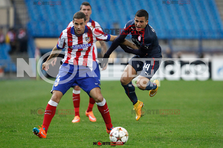 Atletico de Madrid´s Mario Suarez (L) and Olympiacos´s Elabdellaoui during Champions League soccer match between Atletico de Madrid and Olympiacos at Vicente Calderon stadium in Madrid, Spain. November 26, 2014. (ALTERPHOTOS/Victor Blanco) /NortePhoto