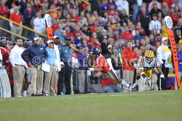 Ole Miss wide receiver Donte Moncrief (12) makes a catch vs. LSU cornerback Jalen Collins (32) at Tiger Stadium in Baton Rouge, La. on Saturday, November 17, 2012. LSU won 41-35.....