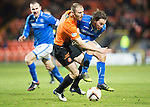 Dundee United v St Johnstone...12.03.14    SPFL<br /> Sean Dillon tackles Stevie May<br /> Picture by Graeme Hart.<br /> Copyright Perthshire Picture Agency<br /> Tel: 01738 623350  Mobile: 07990 594431
