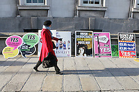 24/11/2010. A woman walks pass Lisbon treaty posters left outside the department of Finance in Dublin. Picture James Horan/Collins