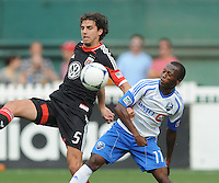 D.C. United  defender Dejan Jakovic (5) goes against Montreal Impact forward Sanna Nyassi (11) D.C. United defeated Montreal Impact 3-0 at RFK Stadium, Saturday June 30, 2012.