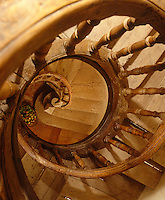 A walnut wood stairwell spirals down three floors and is so rare it is protected by Les Monuments Historiques de France