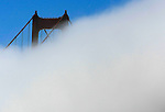 The summer August fog rolled through the Golden Gate Bridge cooling of the San Francisco Bay, California.